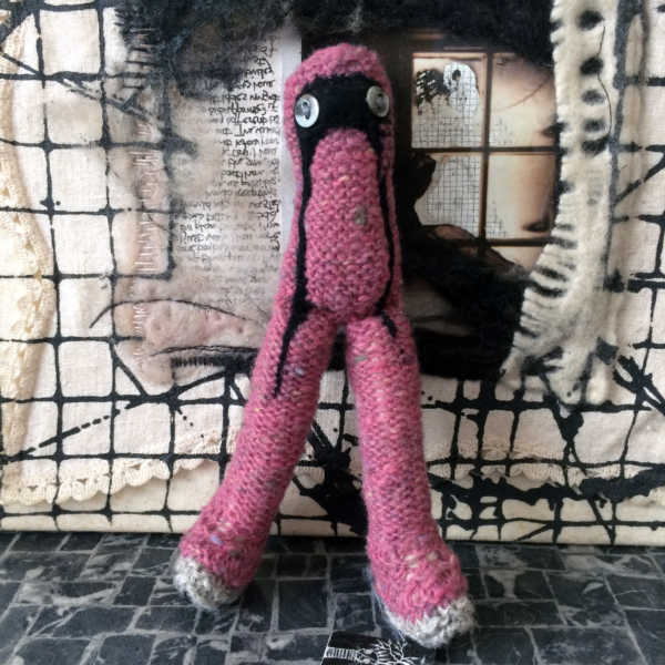Hand knitted pink creature creepy art doll. Only one available.